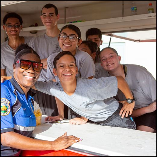 Police Explorers and officer smiling